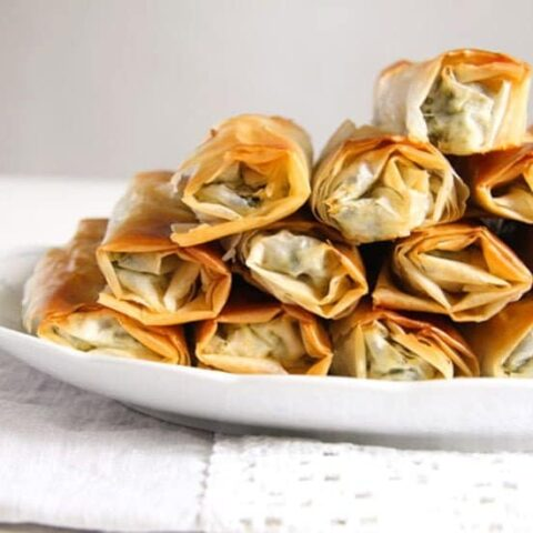 staple of albanian spinach rolls with feta on large platter