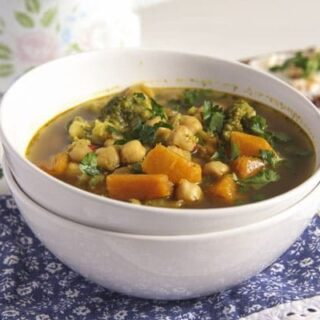 broccoli and sweet potato soup with chickpeas in a small white bowl