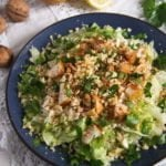 pear salad with cheese and walnuts on a plate