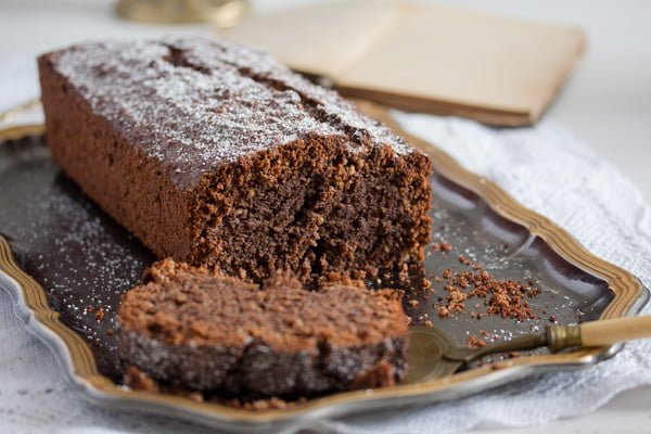 moist breadcrumb cake on a vintage platter