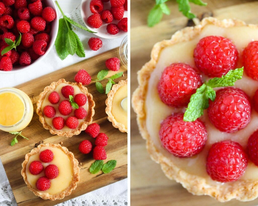 many mini tarts filled with curd and raspberries