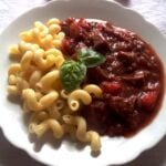 seitan dish with tomato sauce and pasta on a plate