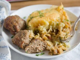 savoy cabbage casserole with meatballs on a plate