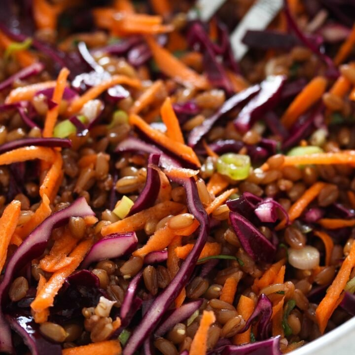 cooked spelt, red cabbage and carrots in a bowl