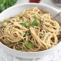 white bowl full of pasta with aubergine sauce