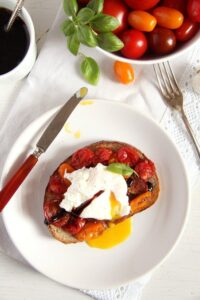 poached egg 200x300 Roasted Tomatoes and Poached Eggs on Garlic Sourdough Toast