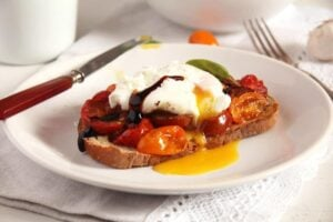 poached egg basil 300x200 Roasted Tomatoes and Poached Eggs on Garlic Sourdough Toast