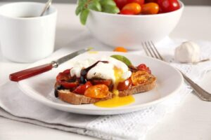 poached egg tomatoes 300x200 Roasted Tomatoes and Poached Eggs on Garlic Sourdough Toast