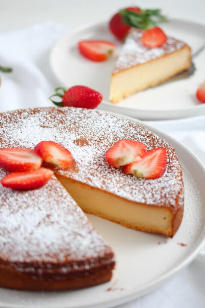 marzipan cake decorated with icing sugar and strawberries