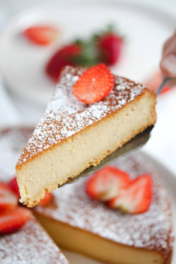 slice of marzipan cake decorated with strawberries