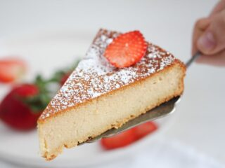 slice of two ingredient cake with strawberries on top