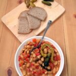 romanian beans or iahnie served in a white bowl with bread