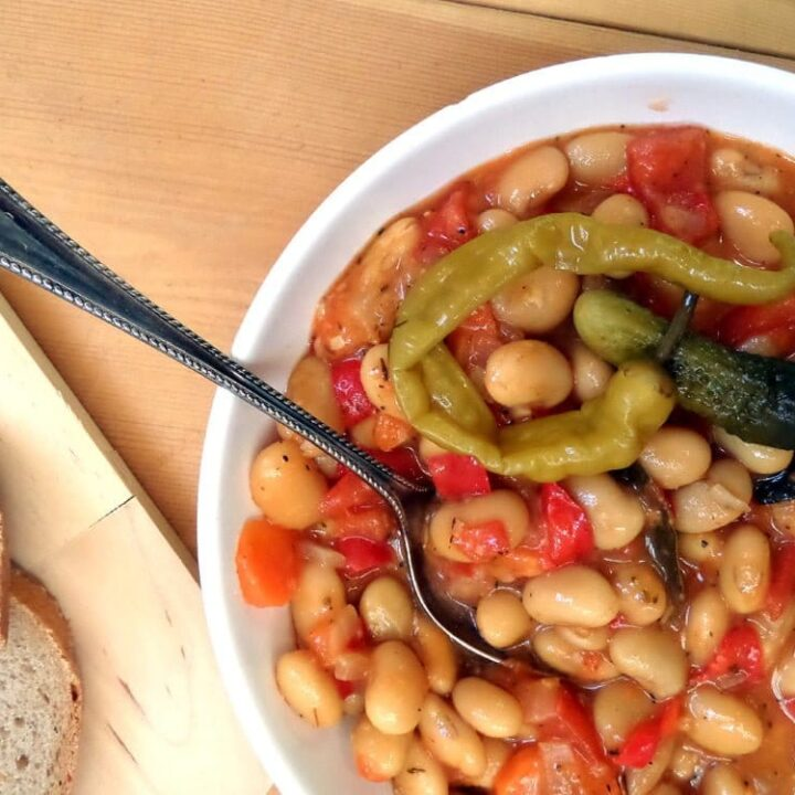 white bean stew in a white bowl