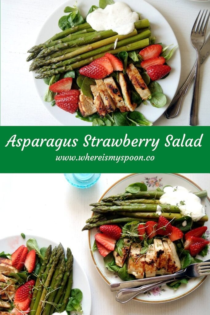 plates with asparagus salad with chicken, strawberries and mache