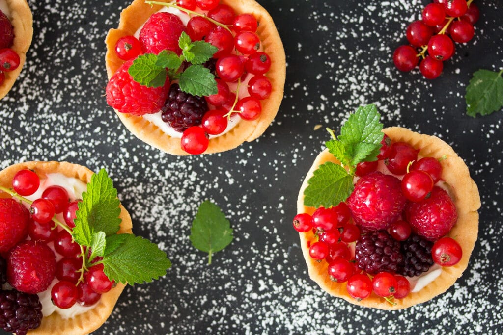 berry cups with raspberries and red currants