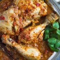 plate with chicken legs in curry sauce