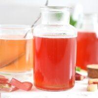 rhubarb simple syrup in a small bottle
