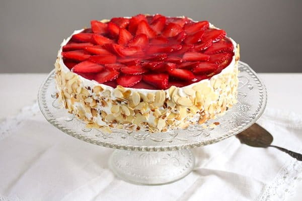 strawberry yogurt cheesecake on a cake platter