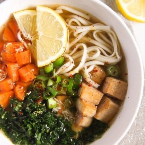 bowl with noodles, tofu and vegetables in broth
