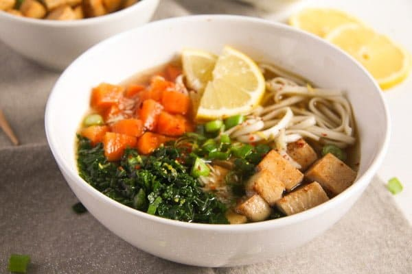 vegan soba noodle soup with kale in a bowl