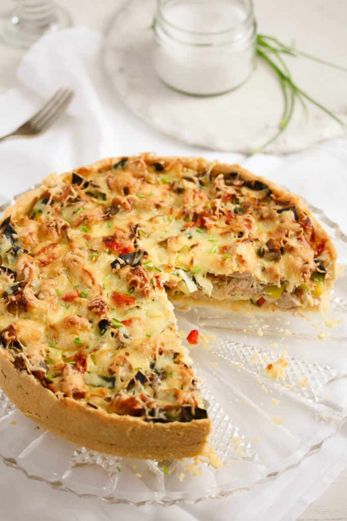 cut chicken pie with vegetable ready to be served