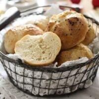 basket full of freshly baked breakfast rolls