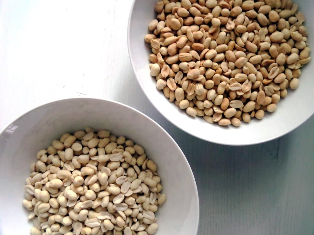 how to roast peanuts unroasted and roasted peanuts in two bowls