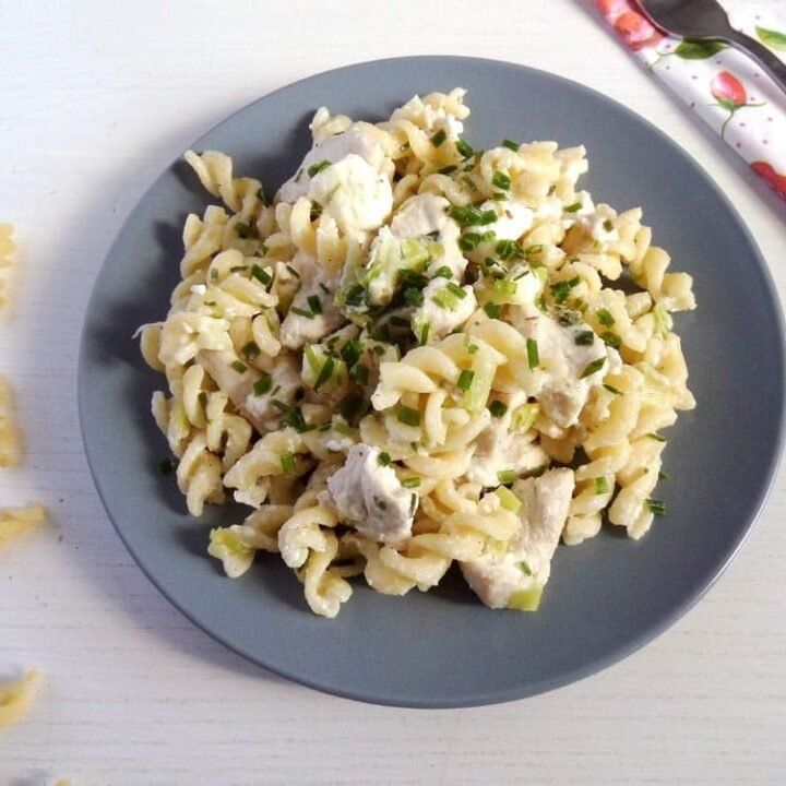 feta pasta with chicken pieces on a small plate
