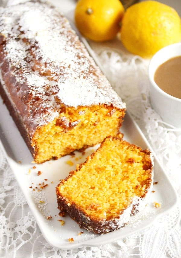 sliced carrot coconut loaf cake with lemon frosting