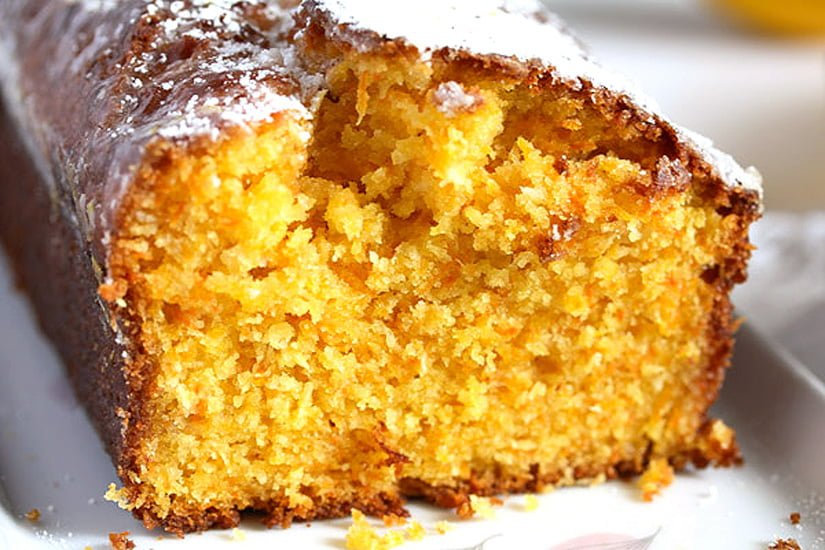sliced carrot loaf cake with coconut
