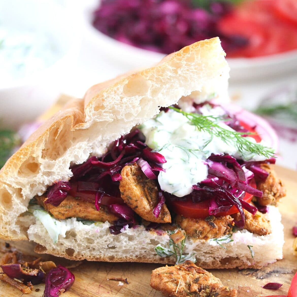 german gyros or doner kebab with tzatziki on a wooden board