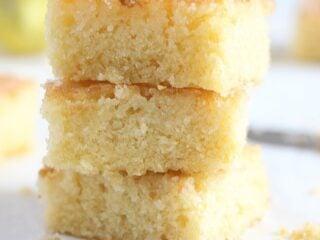 lemon drizzle tray bake cut into squares.
