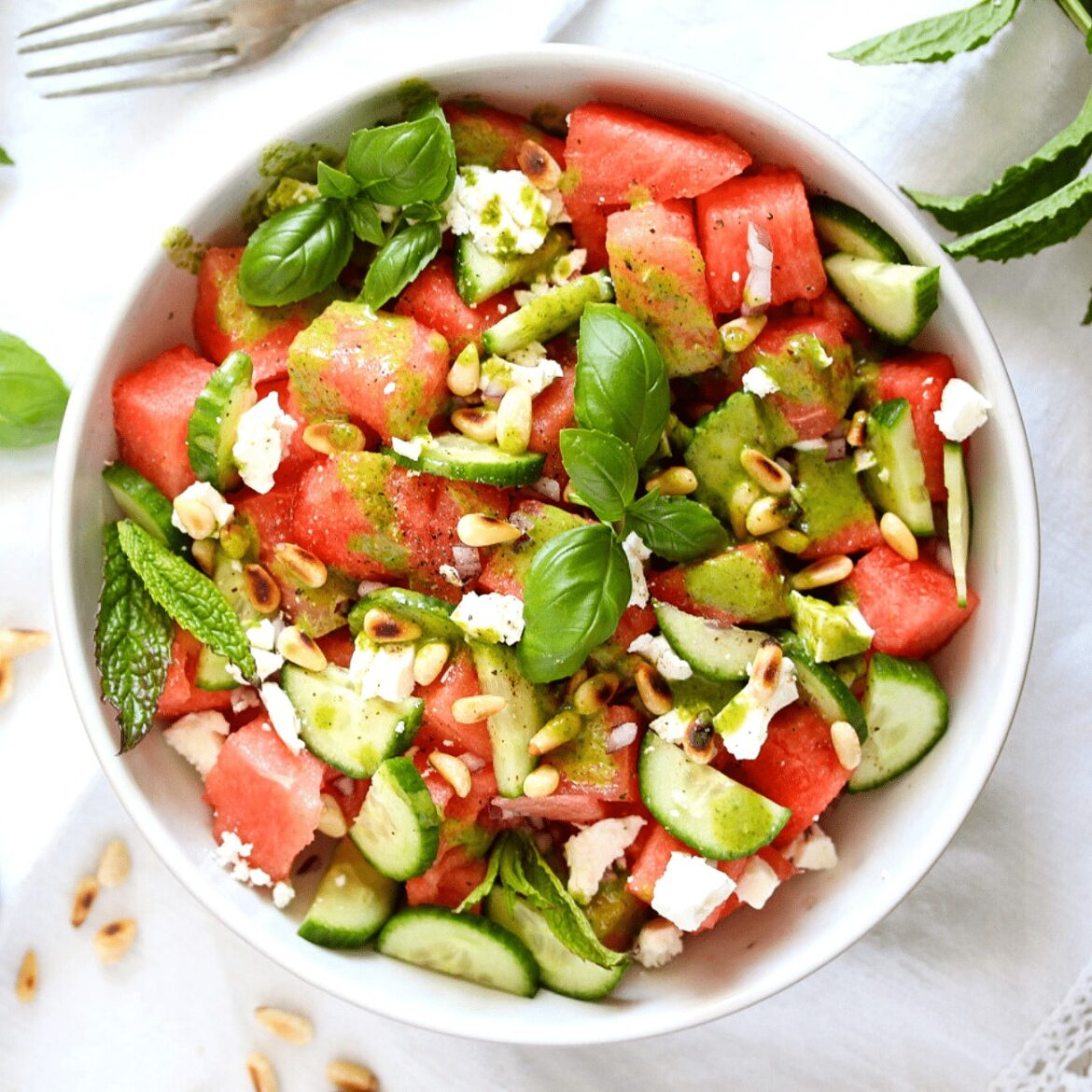 watermelon feta balsamic salad in a white bowl