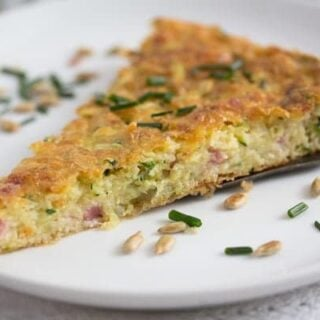 slice of zucchini pie with chives and sunflower seeds