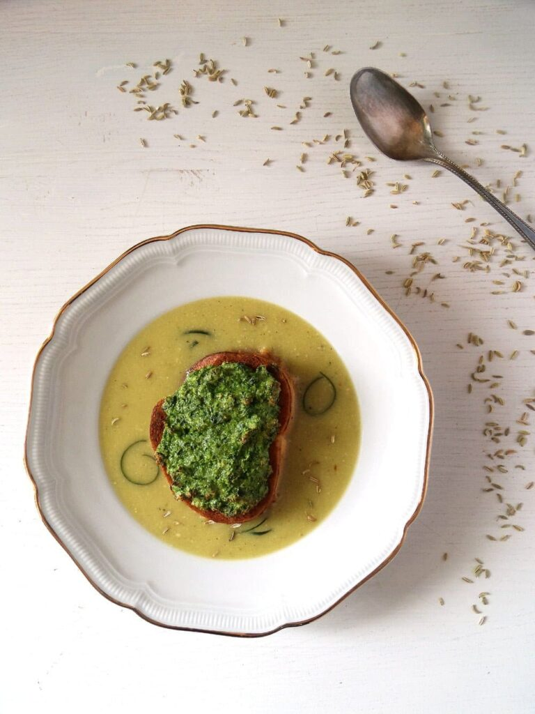 soup with zucchini and fennel seeds in a soup plate
