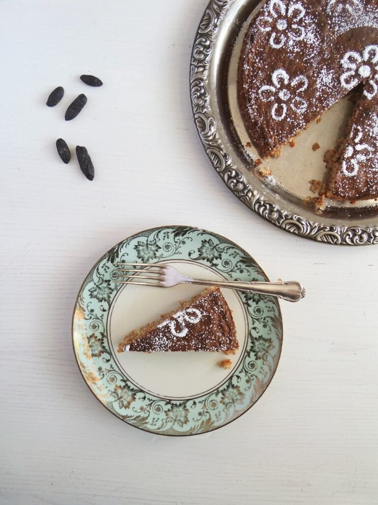 tonka cake with ground almonds on a green plate