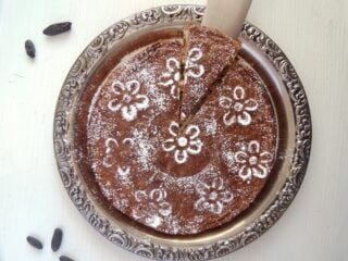 round arabic cake with tonka beans on a silver platter
