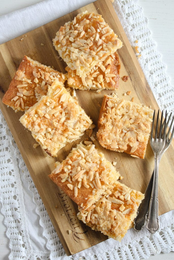 german coffee cake with sugar almond topping on a wooden board