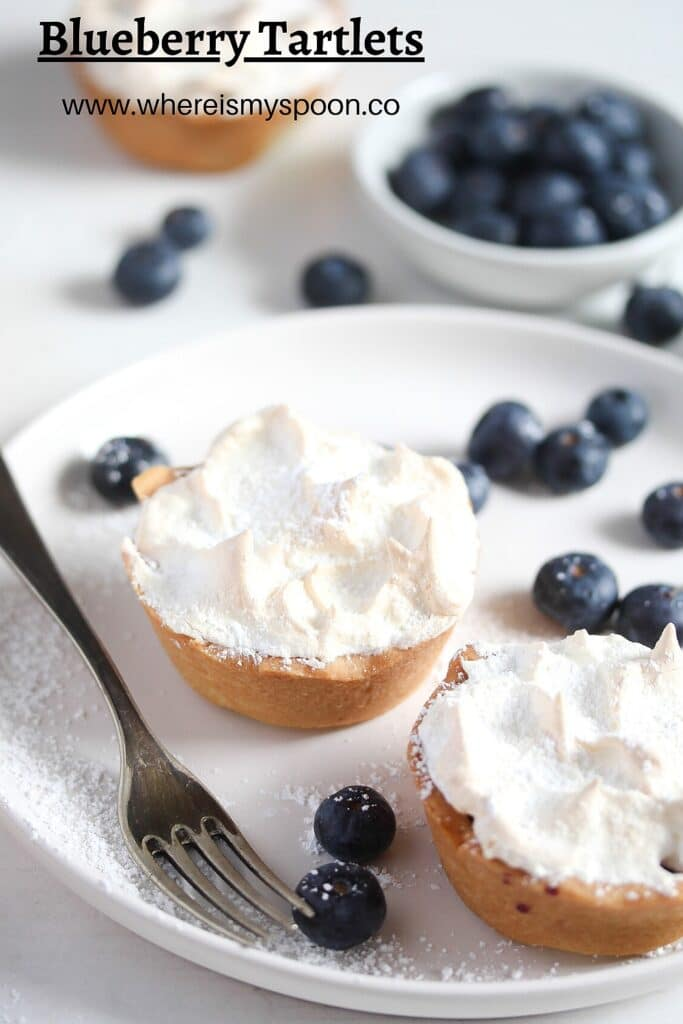 two mini tarts with blueberries and meringue