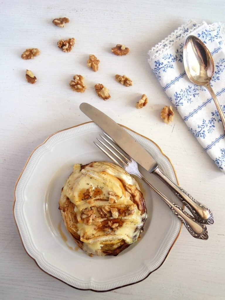 roasted cabbage steaks with camembert and walnuts