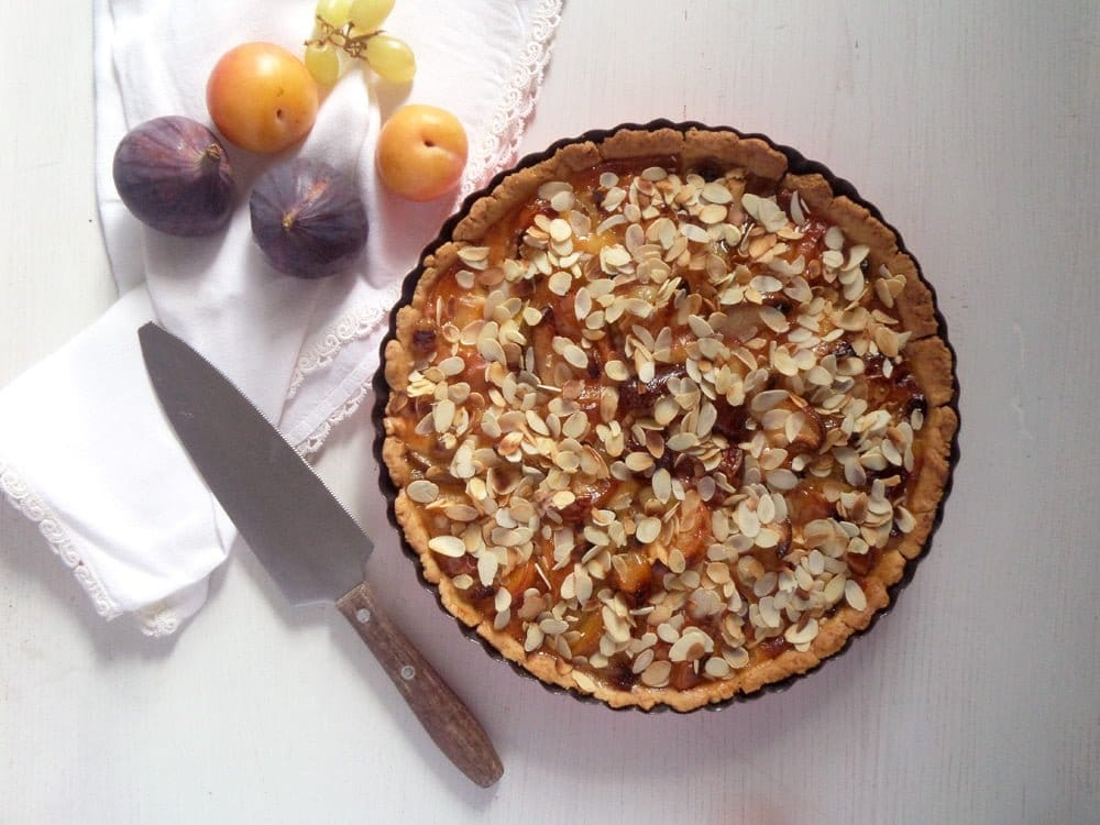 orchard pie with mixed fruit and almond topping