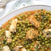 Romanian chicken and peas stew close up ready to be served