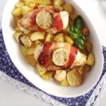 casserole dish with potatoes, chicken and limes
