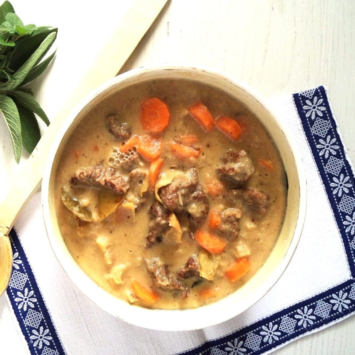 dutch oven beef apple stew in a serving bowl