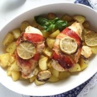 bacon wrapped chicken with herbs and potatoes