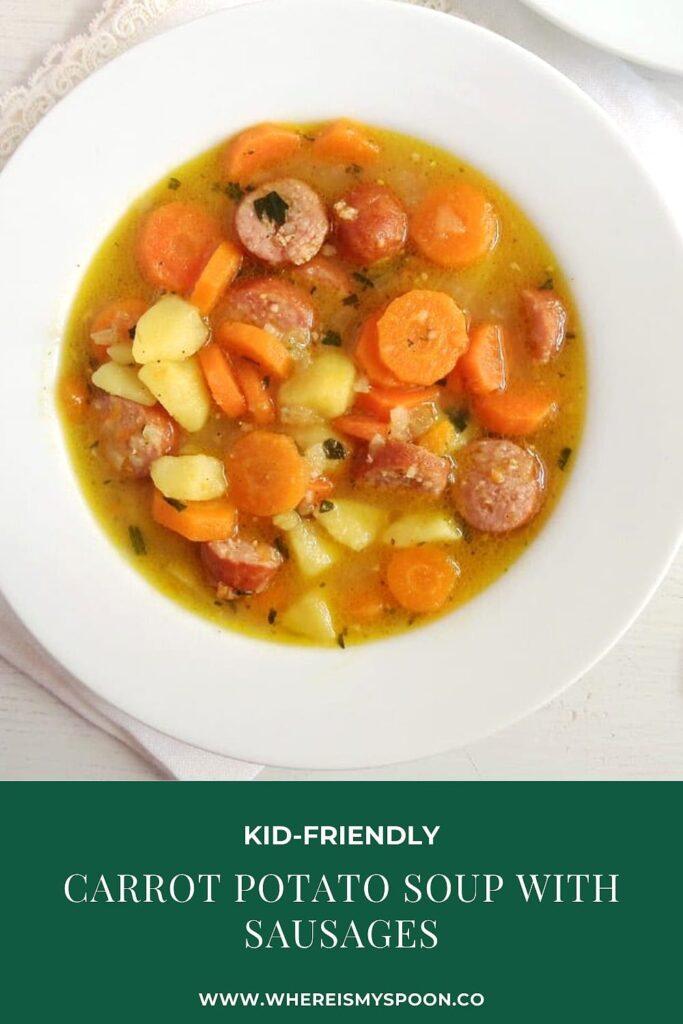 carrot potato sausage soup on a white plate