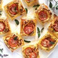 puff pastry party nibbles with mint leaves on the table