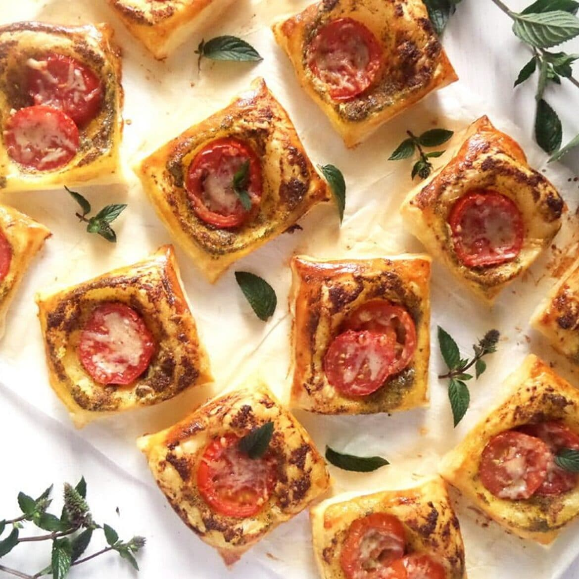 puff pastry nibbles with pesto on the table