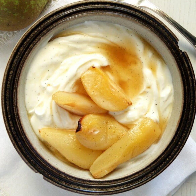 honey pears served on vanilla greek yogurt