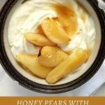 bowl of vanilla yogurt with pear halves on top